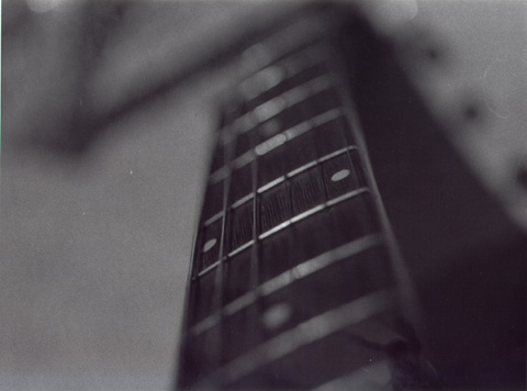 fretboard of my eko acoustic. camera - pentax mx. film - ilford hp5 plus